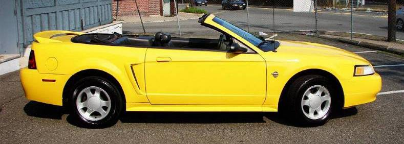 1999 Chrome Yellow Mustang Convertible right side
