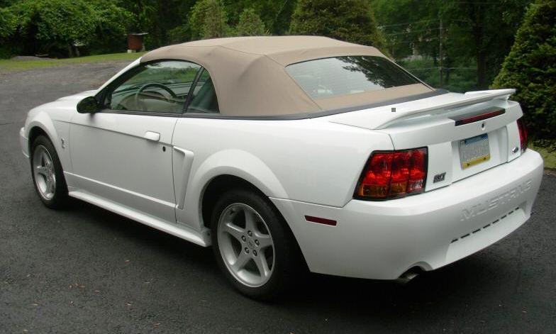 1999 Crystal White Cobra convertible rear left