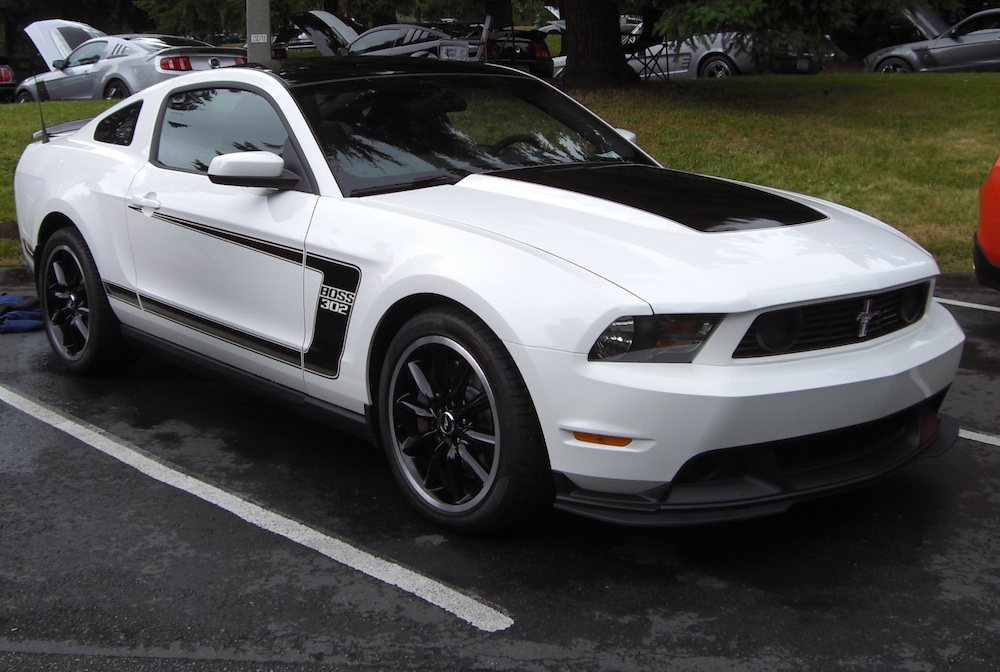 performance white 2012 boss 302 mustang coupe at the 2011 mustang round up car show in bellevue washington later on the last day of the show - Mustang 2012 White